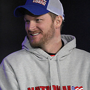 NASCAR Sprint Cup driver Dale Earnhardt Jr. (88) is seen during the driver introductions prior to the NASCAR Sprint Unlimited Race at Daytona International Speedway on Saturday, February 16, 2013 in Daytona Beach, Florida.  (AP Photo/Alex Menendez)