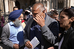 © Licensed to London News Pictures. 23/04/2021. London, UK. Former Post Office sub-postmaster Harjinder Butoy (C)  reacts to the verdict outside The High Court. The Appeal Court has cleared the names of a group of 42 sub-postmasters - some of whom were jailed for stealing money after the Horizon accounting software was installed at Post Offices. At a previous High Court hearing a judge found the Fujitsu accounting system had major faults and defects. The Post Office has already agreed to pay £58m in a settlement with more than 500 sub-postmasters. <br /> Six convictions were overturned last year . Photo credit: Peter Macdiarmid/LNP