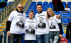Leicester City fans wear shirts bearing a picture of Vichai Srivaddhanaprabha that read 'The Boss' during the Premier League match at the Cardiff City Stadium, Cardiff.
