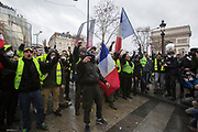 December, 8th, 2018 - Paris, Ile-de-France, France: Demonstrators near Arc de Triomphe on Champs Elysees. The French 'Gilets Jaunes' demonstrate a fourth day. Their movement was born against French President Macron's high fuel increases. They have been joined en mass by students and trade unionists unhappy with Macron's policies. Nigel Dickinson