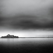 www.aziznasutiphotography.com             Munkholmen (Norwegian: the monk's islet) is an islet north of Trondheim, Norway. It sits in the Trondheimsfjord about 1.3 kilometres (0.81 mi) northwest of the island of Brattøra and the mouth of the river Nidelva. The islet has served as a place of execution, a monastery, a fortress, prison, and a World War II anti-aircraft gun station. Today, Munkholmen is a popular tourist attraction and recreation site.  In the years prior to the founding of the city of Trondheim in 997 by Viking King Olav Tryggvason, Munkholmen was used as an execution site by the Jarls of Lade. The arrival of Olav Tryggvason to Norway in 995 coincided with a revolt against Haakon Sigurdsson, who was killed by Tormod Kark. The severed heads of both Haakon and Kark were placed on stakes on Munkholmen facing out into the fjord to serve as a warning to visitors. Legend has it that before entering Trondheim, visitors were made to spit on these heads as a tribute to King Olav I of Norway. The tradition of displaying the severed heads of criminals and political opponents was continued for some time, but the heads were now placed so that they faced the city of Trondheim to deter its citizens from committing crimes.(Wiki)