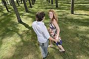Young Couple walking through trees at Paterson, NSW, Australia