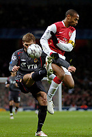 Photo: Ed Godden.<br /> Arsenal v CSKA Moscow. UEFA Champions League, Group G. 01/11/2006. Arsenal's Thierry Henry (R) colides with Aleksei Berezutskiy.