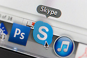 A detail from a computer screen of the Skype icon.