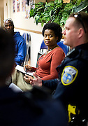 MILWAUKEE, WI – MARCH 28: Tijuandria Smith listens to Milwaukee Police Department officer Jesse Busshardt during a Zeidler Center Police and Resident discussion circle at Grace Fellowship Church on Monday, March 28, 2016.