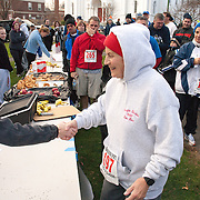 84 year old female runner picks up her category award at the Burbank YMCA 21st Annual 5K Classic, Wakefield, MA, Nov. 20,2010