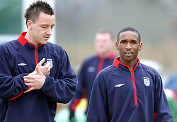 John Terry (left) and Jermain Defoe during the training session at London Colney, Hertfordshire, ahead of the international friendly match against Sweden.  THIS PICTURE CAN ONLY BE USED WITHIN THE CONTEXT OF AN EDITORIAL FEATURE. NO WEBSITE/INTERNET USE UNLESS SITE IS REGISTERED WITH FOOTBALL ASSOCIATION PREMIER LEAGUE.