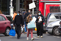 © Licensed to London News Pictures.  12/04/2021. London, UK. Shoppers are seen carrying heavy bags outside IKEA at Greenwich south London as the government takes the next step on its lockdown-lifting road map and non-essential shops reopen today. Photo credit: Marcin Nowak/LNP
