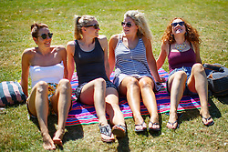© Licensed to London News Pictures. 15/08/2016. London, UK. A group of women enjoy hot weather and sunshine in Regent's Park, London on Monday, 15 August 2016. Photo credit: Tolga Akmen/LNP