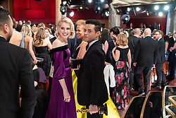 Lucy Boyton and Rami Malek pose with the Oscar® for performance by an actor in a leading role during the live ABC Telecast of The 91st Oscars® at the Dolby® Theatre in Hollywood, CA on Sunday, February 24, 2019.
