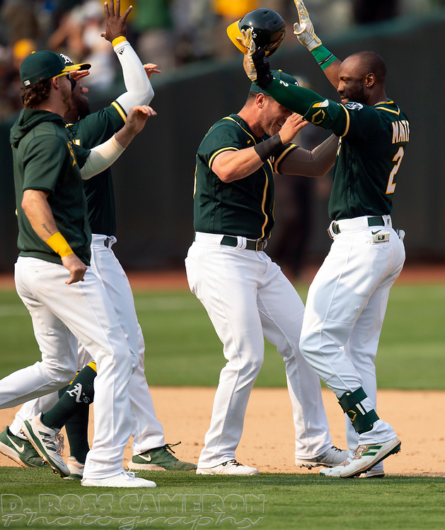 Sep 25, 2021; Oakland, California, USA; Oakland Athletics center fielder Starling Marte (2) is greeted by his teammates after getting the game-winning hit against the Houston Astros during the ninth inning at RingCentral Coliseum. Mandatory Credit: D. Ross Cameron-USA TODAY Sports