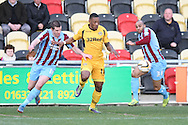 Ryan Jackson of Newport County surges between Eddie Nolan and Marcus Williams of Scunthorpe. Skybet football league 2 match, Newport county v Scunthorpe Utd at Rodney Parade in Newport, South Wales on Saturday 1st March 2014.<br /> pic by Mark Hawkins, Andrew Orchard sports photography.