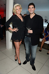 ZAFAR RUSHDIE and NATALIE COYLE at a party to celebrate the 160th anniversary of Tissot held at the Supperclub, 12 Acklam Road, London, W10 on 17th October 2013.