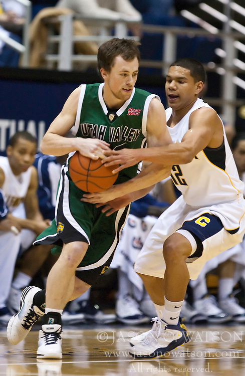 December 28, 2009; Berkeley, CA, USA;  Utah Valley Wolverines guard Eric Dearden (20) is guarded by California Golden Bears guard Brandon Smith (12) during the first half at the Haas Pavilion.  California defeated Utah Valley 85-51.
