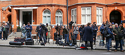 © Licensed to London News Pictures. 05/04/2019. London, UK. National and international members of the media outside the Ecuadorian Embassy in Knightsbridge. Media reports state that the Ecuadorian Embassy plan to remove Julian Assange, Wikileaks founder from the embassy within days. Julian Assange claimed political asylum in the Ecuadorean Embassy in June 2012 after he was accused of rape and sexual assault against women in Sweden. Photo credit: Dinendra Haria/LNP