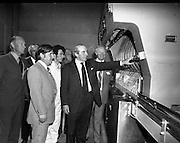 New Bottling plant for D.E.Williams..1975..19.06.1975..06.19.1975..19th June 1975..The Minister for Justice, Mr Patrick Cooney TD, officially opened the new one and a half million gallon per annum soft drink facility at Tullamore,Co Offaly. The new plant represents an investment of over a quarter million pounds by the Williams Group. It is hoped that this investment will create further employment for the area...Pictured officially starting up the new machinery,The Minister for Justice,Mr Patrick Cooney, is watched by members of the D E Williams board of directors.
