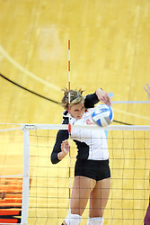 13 September 2011: Brooklyn Hlafka pounds the ball over the net and to the front corner during an NCAA volleyball match between the Ramblers of Loyola and the Illinois State Redbirds at Redbird Arena in Normal Illinois.