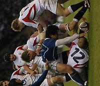 Photo: Ian Hebden.<br />England v Samoa. Autumn Internationals. 26/11/05.<br />Steve Borthwick and Elvis Saveali'i grapple for the ball.