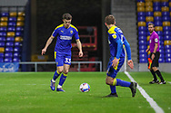 AFC Wimbledon midfielder Callum Reilly (33) about to pass the ball during the EFL Sky Bet League 1 match between AFC Wimbledon and Bristol Rovers at Plough Lane, London, United Kingdom on 5 December 2020.