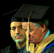 Omaha Neb, 5/25/05  Afghanistan President Hamid Karzai listens to Omaha Mayor Mike Fahey as he gives a speech at the University of Nebraska at Omaha Wednesday evening. (Chris Machian)
