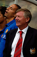 Fotball<br /> Foto: SBI/Digitalsport<br /> NORWAY ONLY<br /> <br /> Clyde v Manchester United, Preseason Friendly. 16/07/2005.<br /> <br /> Manchester United manager Sir Alex Ferguson, with Rio Ferdinand in the background.