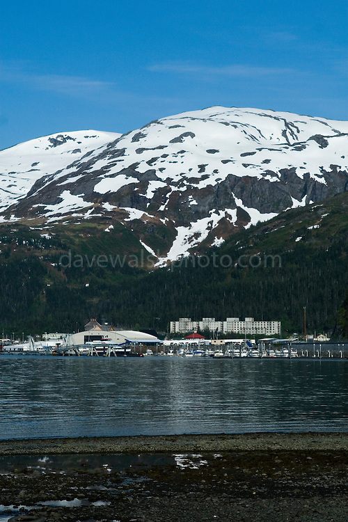 """The strangest town in Alaska, Whittier - only reachable by tunnel or ship. It's a stop off point for Cruise ships, and the Alaska raildroad. 90% of inhabitants live in one building! Originally established as a military base during World War two.......The square structure is the Buckner Building - """"A city under one roof"""". Built in 1953, this derelict building was abandoned but can't be demolished due to the amount of asbestos inside. It was damaged by earthquake in  1964."""