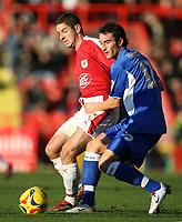 Photo: Rich Eaton.<br /> <br /> Bristol City v Millwall. Coca Cola League 1. 16/12/2006. Alex Russell left of Bristol sends the ball past Danny Senda