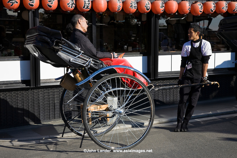 Arashiyama Rickshaw Pullers - Rickshaws still ply the streets of Arashiyama in the rural part of Kyoto. Nowadays the rickshaw pullers tend to be university students, working at a part-time job rather than this being a blue-collar low level job.