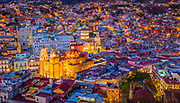 ------<br /> Guanajuato is a city and municipality in central Mexico and the capital of the state of the same name. It is part of the macroregion of Bajío. It is in a narrow valley, which makes its streets narrow and winding. Most are alleys that cars cannot pass through, and some are long sets of stairs up the mountainsides. Many of the city's thoroughfares are partially or fully underground. The historic center has numerous small plazas and colonial-era mansions, churches and civil constructions built using pink or green sandstone.<br /> <br /> The origin and growth of Guanajuato resulted from the discovery of minerals in the mountains surrounding it. The mines were so rich that the city was one of the most influential during the colonial period. One of the mines, La Valenciana, accounted for two-thirds of the world's silver production at the height of its production.<br /> <br /> The city is home to the Mummy Museum, which contains naturally mummified bodies that were found in the municipal cemetery between the mid 19th and 20th centuries. It is also home to the Festival Internacional Cervantino, which invites artists and performers from all over the world as well as Mexico. Guanajuato was the site of the first battle of the Mexican War of Independence between insurgent and royalist troops at the Alhóndiga de Granaditas. The city was named a World Heritage Site in 1988.