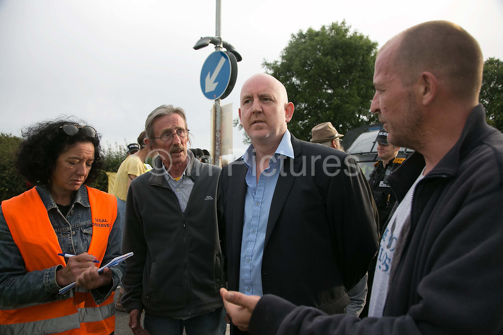 12 local activists locked themselves in specially made arm tubes to block the entrance to Quadrillas drill site in New Preston Road, July 03 2017, Lancashire, United Kingdom. A solicitor visits the protest to hear the complaints about police brutality and tresspass.The 13 activists included 3 councillors; Julie Brickles, Miranda Cox and Gina Dowding and Nick Danby, Martin Porter, Jeanette Porter,  Michelle Martin, Louise Robinson,<br /> Alana McCullough, Nick Sheldrick, Cath Robinson, Barbara Cookson, Dan Huxley-Blyth. The blockade is a repsonse to the emmidiate drilling for shale gas, fracking, by the fracking company Quadrilla. Lancashire voted against permitting fracking but was over ruled by the conservative central Government. All the activists have been active in the struggle against fracking for years but this is their first direct action of peacefull protesting. Fracking is a highly contested way of extracting gas, it is risky to extract and damaging to the environment and is banned in parts of Europe . Lancashire has in the past experienced earth quakes blamed on fracking.