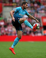 Football - 2016 / 2017 Premier League - Southampton vs. Swansea City<br /> <br /> Angel Rangel of Swansea City controls a pass at St Mary's Stadium Southampton <br /> <br /> Colorsport/Shaun Boggust