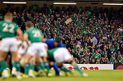 Ireland supporters in the crowd celebrate their team's performance - Mandatory byline: Patrick Khachfe/JMP - 07966 386802 - 11/10/2015 - RUGBY UNION - Millennium Stadium - Cardiff, Wales - France v Ireland - Rugby World Cup 2015 Pool D.