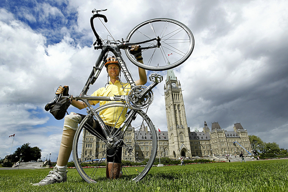 David Visschedyk, 26, who is cycling across Canada for children's cancer charities is seen on Parliament Hill on Aug 15, 2006. Visschedyk who was  diagnosed with osteogenic sarcoma at the age of eight had to have his right leg amputated due to the disease..(Ottawa Sun Photo By Sean Kilpatrick)