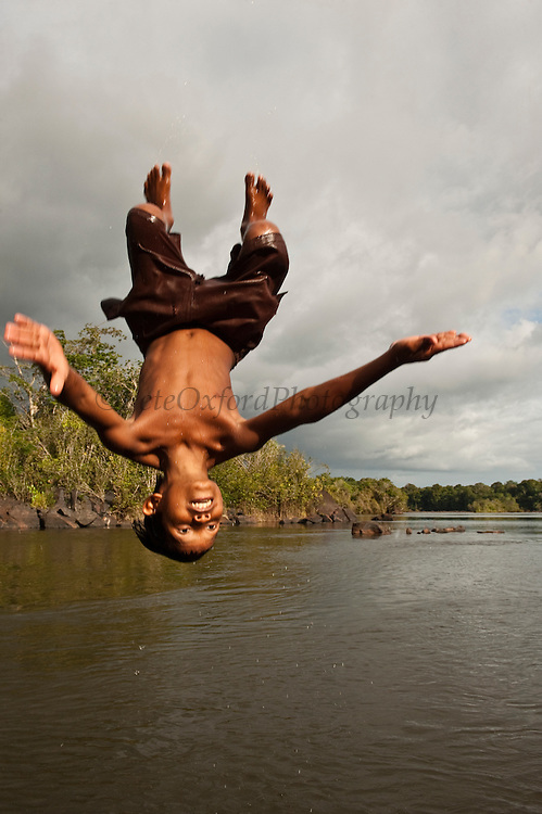 Boy Somersaulting<br /> Essequibo River,<br /> Rupununi<br /> Guyana<br /> South America