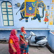 Colorful sarees and colorful paintings in the streets of Udaipur old town