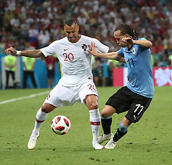 SOCHI, June 30, 2018  Ricardo Quaresma (L) of Portugal vies with Diego Laxalt of Uruguay during the 2018 FIFA World Cup round of 16 match between Uruguay and Portugal in Sochi, Russia, June 30, 2018. Uruguay won 2-1 and advanced to the quarter-final. (Credit Image: © Ye Pingfan/Xinhua via ZUMA Wire)
