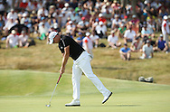 James Morrison (ENG) putts out on the last during Round Three of the 2015 Alstom Open de France, played at Le Golf National, Saint-Quentin-En-Yvelines, Paris, France. /04/07/2015/. Picture: Golffile | David Lloyd<br /> <br /> All photos usage must carry mandatory copyright credit (© Golffile | David Lloyd)