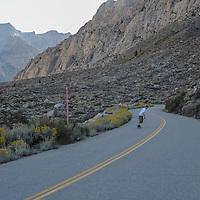 Ben Wiltsie skateboards down Pine Creek Road in the eastern Sierra Nevada near Bishop, California.