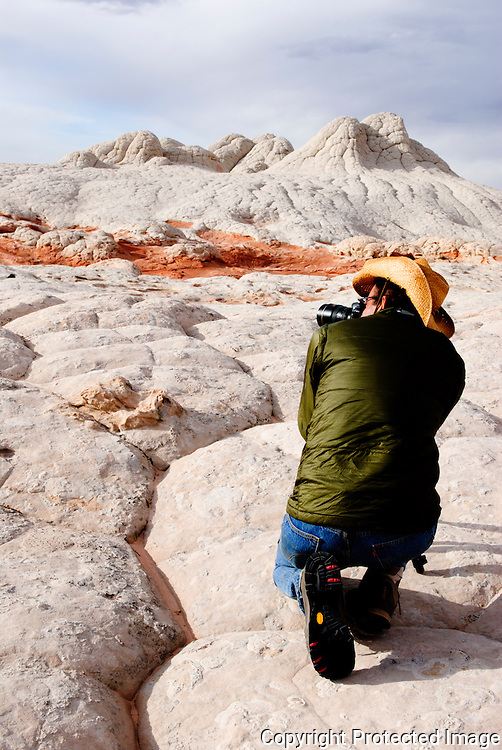 A photographer kneels to take a picture in White Pocket, Coyote Buttes South, Arizona. Missoula Photographer