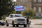 26 SEPTEMBER 2020 - DES MOINES, IOWA: A truck flying a Trump campaign flag pulls into a parking lot at the Iowa State Capitol during a motorcade supporting the reelection of President Donald J. Trump. More than 1,500 people in 500 vehicles participated in motorcade through Des Moines Saturday. They started in the suburbs south of downtown, drove through downtown, and ended at the State Capitol.        PHOTO BY JACK KURTZ