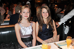 Left to right, SASHA GARDNER and LOTTIE LIVINGSTONE at One Night Only at The Ivy held at The Ivy, 1-5 West Street, London on 2nd December 2012.