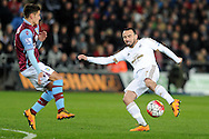 Swansea's Leon Britton (r) is challenged by Aston Villa's Ashley Westwood. Barclays Premier league match, Swansea city v Aston Villa at the Liberty Stadium in Swansea, South Wales on Saturday 19th March 2016.<br /> pic by  Carl Robertson, Andrew Orchard sports photography.