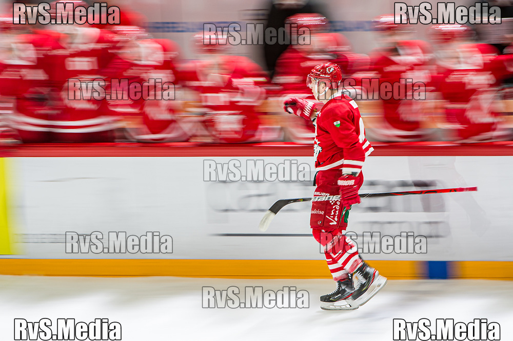 LAUSANNE, SWITZERLAND - NOVEMBER 23: #81 Ronalds Kenins of Lausanne HC celebrates his goal with teammates during the Swiss National League game between Lausanne HC and Geneve-Servette HC at Vaudoise Arena on November 23, 2019 in Lausanne, Switzerland. (Photo by Robert Hradil/RvS.Media)