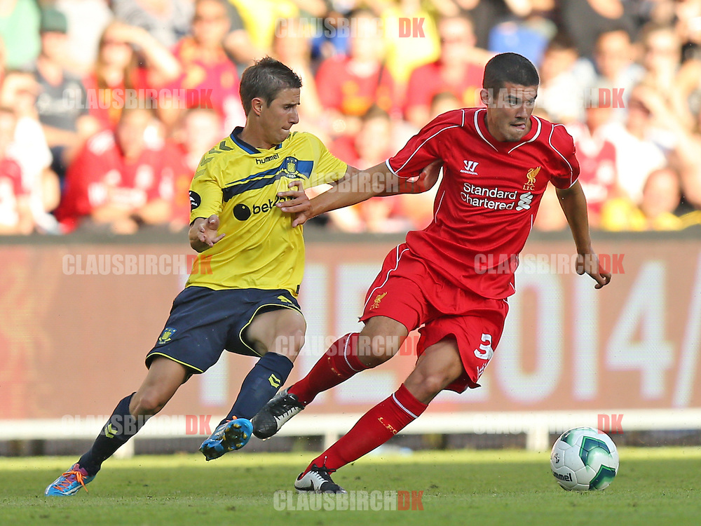 FODBOLD: Connor Coady (Liverpool) i kamp med Alexander Szymanowski (Brøndby) under træningskampen mellem Brøndby IF og Liverpool FC den 16. juli 2014 på Brøndby Stadion. Foto: Claus Birch