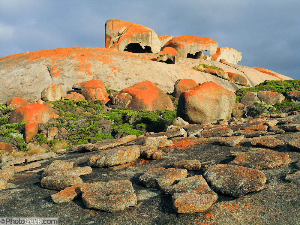 """The Remarkable Rocks form fantastic shapes in Flinders Chase National Park, Kangaroo Island, South Australia. The Remarkable Rocks began as magma injected into a sedimentary rock layer and crystallized into a single granite monolith a few kilometers below the earths surface. Subsurface weathering cracked the granite along joint planes and created corestones. Erosion peeled away the surface and revealed the corestones, which were sculpted asymmetrically by the affects of rain and prevailing southerly winds. Published in """"Light Travel: Photography on the Go"""" book by Tom Dempsey 2009, 2010."""