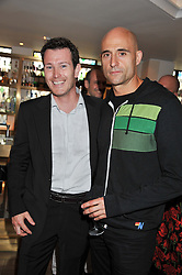 Left to right, actors NICK MORAN and MARK STRONG at a party to celebrate the publication on The House of Rumour by Jake Arnott held at The Ivy Club, West Street, London on 9th July 2012.