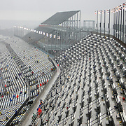 Fans are forced to clear their seats on the front stretch as rain causes a delay during the 56th Annual NASCAR Daytona 500 practice session at Daytona International Speedway on Saturday, February 22, 2014 in Daytona Beach, Florida.  (AP Photo/Alex Menendez)