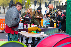 A camp kitchen erected on Oxford Street serves breakfast as hundreds of environmental protesters from Extinction Rebellion occupy Marble Arch, camping in the square and even on the streets, blocking access to traffic on Park Lane and Oxford Street in London's usually traffic-heavy west end. . London, April 16 2019.