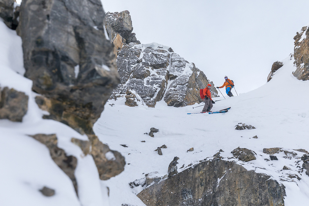 Ian Welsted and Brandon Parker skiing Pac Man Couloir at Bow Summit in the Canadian Rockies.