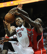 November 1, 2013 - Atlanta:  Toronto Raptors  Amir Johnson (15) looses the ball after he was hit by Atlanta Hawk Paul Millsap (4) in the first period during the Atlanta Hawks home opener against the Toronto Raptors inside Philips Arena on Friday, November 1, 2013. Hawks won the game 102 -95..   ©2013 Johnny Crawford